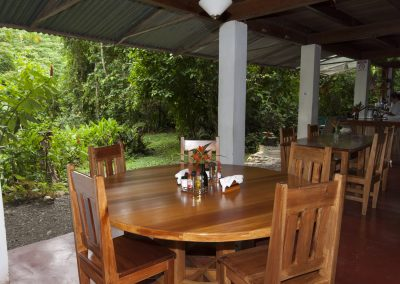The dining room furniture is hand crafted with sustainable tropical hardwoods