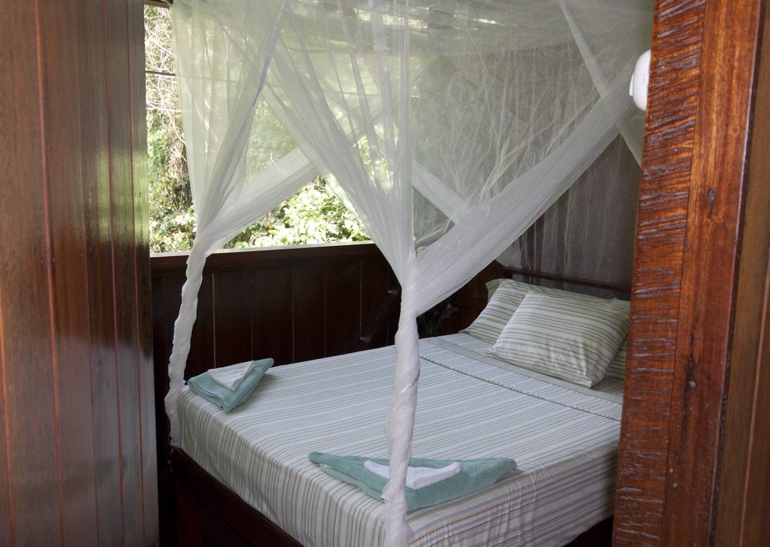 Our lodge uses fine fabrics and romantic netting for the beds