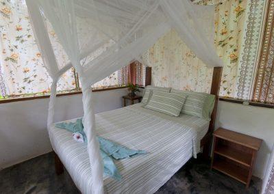 Romantic nets drape the bed